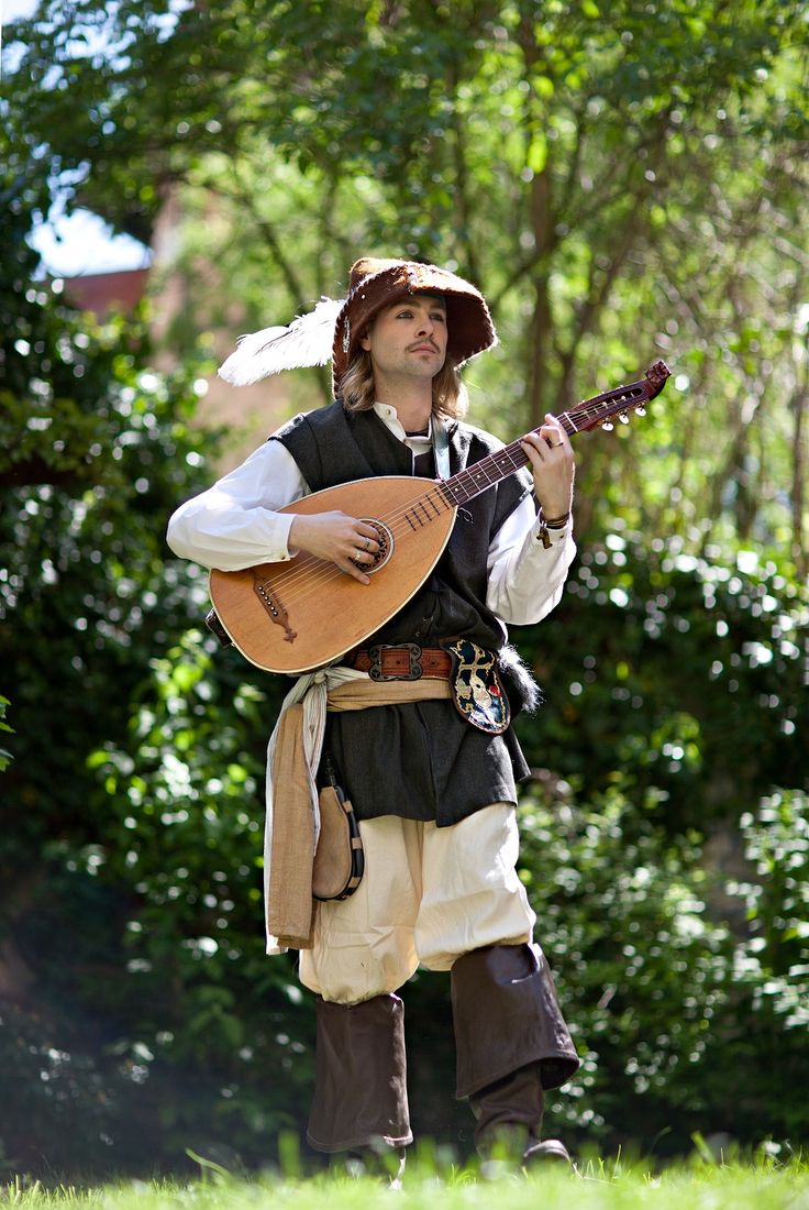 This is a picture of a Troubadour playing a Lute. The Lute is very similar to the guitar but has a bit of a different shape. Also a very popular instrument played but plucking the strings so that they vibrate.