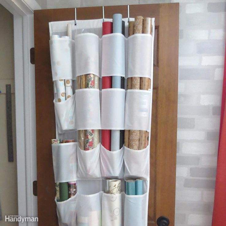 Use an over the door shoe hanger to keep wrapping paper and supplies in one place and out of the way. Measure the length of your rolls and cut the bottom seams on pockets that need to allow the roll to pass through, leaving the bottom pocket intact. Leave single pockets to sort and store scissors, tape and ribbon.