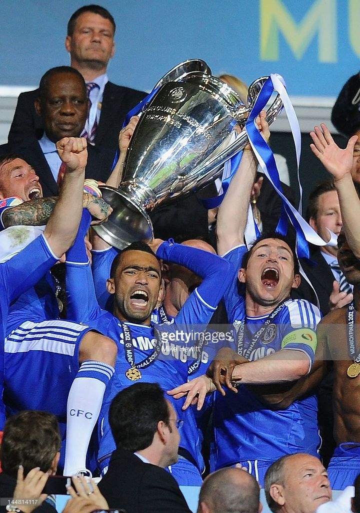 Frank Lampard (R) and Jose Bosingwa (C) of Chelsea lift the trophy in celebration after their victory in the UEFA Champions League Final between FC Bayern Muenchen and Chelsea at the Fussball Arena München on May 19, 2012 in Munich, Germany.