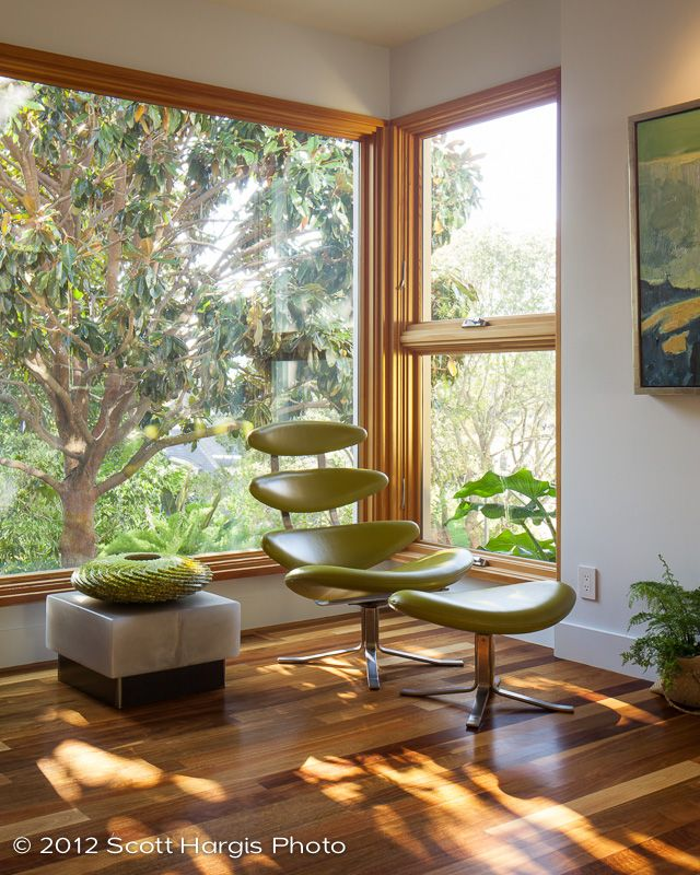 Mid Century Modern. We bought this chair in LA from Modernica just before they stopped making them. When the white version turned up in Roger's office in Mad Men, someone else started making them for six times the price! Our living room. Resin tables. Nic Coley painting, Australian spotted gum floors