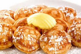#Dutch #poffertjes, tiny thick #pancakes with sugar and butter on top. Yummy!