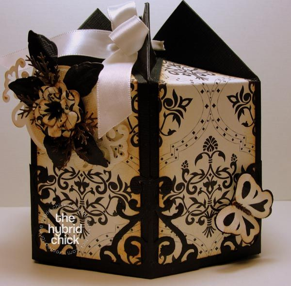Hexagon box created with a milk carton template. Used digital papers. Stunning!