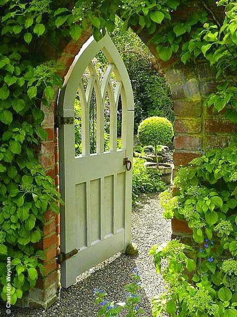 Gothic shaped painted garden doorway