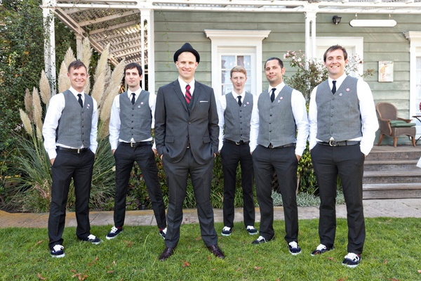 Groomsmen black pants gray vests and use a blush colored tie... minus the silly hat.  I like this.