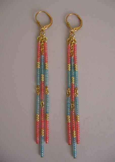 These beautiful dangles are handmade with gold plated cable chain, & transparent coral rainbow, transparent baby blue rainbow, & golden metallic glass seed beads.  They measure 3-7/8 long which includes the plated leverback earwires