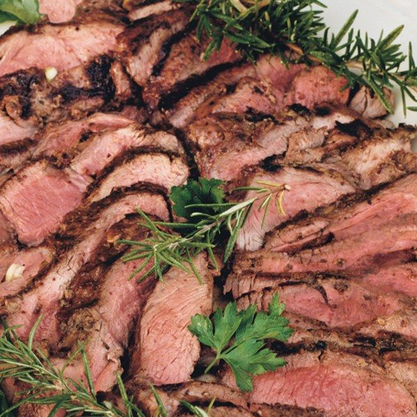 What makes this entrée         so flavorful? Tucking garlic slices into the lamb         and covering the meat with a puree made of         garlic, Dijon mustard, rosemary, and lemon.
