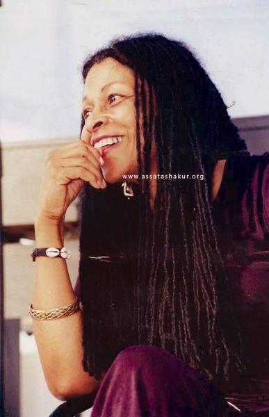 This is Assata Shakur, who is widely known as a member of The Black Panther Party and Black Liberation Army. She and fellow BLA member Zayd Malik Shakur were involved in a shooting, which left her wounded, her BLA brother dead, and one police officer dead.    In prison, Assata was left in solitary confinement for months at a time and beaten almost to paralysis. She managed to escape in 1979, and in 1984, she moved to Cuba.