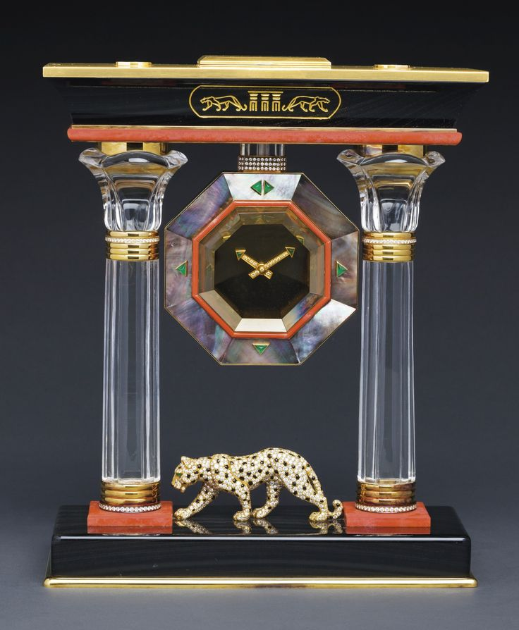 """CARTIER """"THE EGYPTIAN TEMPLE PANTHER PORTICO MYSTERY CLOCK"""" AN IMPORTANT AND VERY RARE YELLOW GOLD, DIAMOND, EMERALD, BLACK MOTHER-OF-PEARL, ROCK CRYSTAL, PINK CORAL, BLACK ENAMEL, BLACK AGATE, SMOKEY QUARTZ, TWO COLUMN MYSTERY CLOCK, IN EGYPTIAN STYLE CIRCA 1990 CASE 620913"""