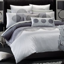 Como: The soft radiance and luminosity of moonlight, the subtle gleam of polished silver and the rich glow of darker pewter unite to create a soothing and calming design that will provide a peaceful bedroom environment. The heavily embroidered circles on Como present an almost hypnotic effect with their careful placement and subtle use of silver highlights on the black embroidery. This is a quilt cover set with a sleek, contemporary feel, reinforcing an atmosphere of serenity.