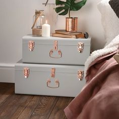 Stack up a unique nightstand with these rose gold-accented foot lockers to wrangle extra bed linens and other random bedroom stuff. | 32 Pieces Of Decor That'll Make Your Home Look So Much Bigger