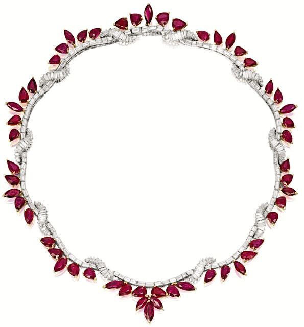 Ruby and diamond necklace.This necklace is composed of fifty-three pear- and marquise-shaped rubies weighing approximately 61.73 carats total, to a necklace set with tapered baguette and baguette diamonds weighing approximately 16.35 carats, mounted in platinum and 18 karat yellow gold. Via Diamonds in the Library.