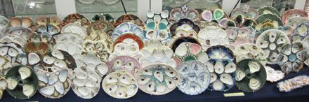 Monique's Antiques, Dunkirk, Md., exhibited its specialty, Majolica, at the Showplace, including this impressive selection of oyster plates.