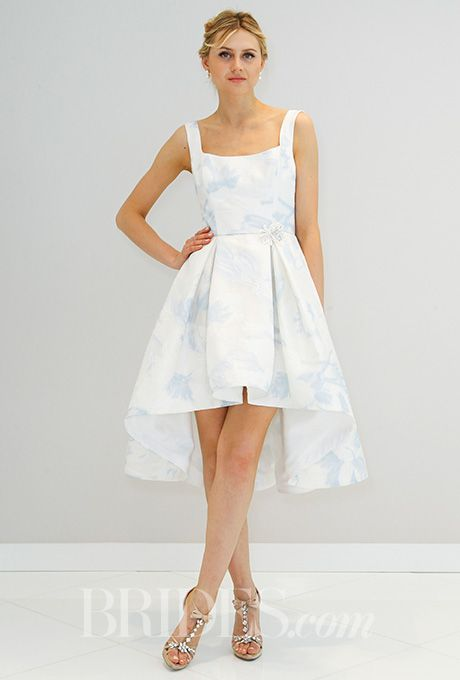 Brides.com: . Randi Rahm's blue printed mini-dress is a subtle take on high-low with a celestial nod.