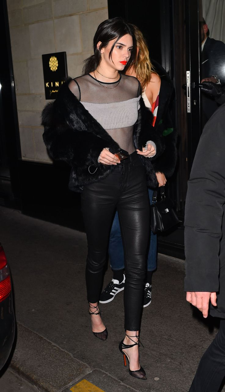 Kendall Jenner rocked a fishnet top, fur coat, and leather pants on the streets of Paris.