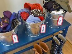 Steel Storage Buckets Holding Rain Gear . One solution that is easy for kids..a drop in the bucket ! #leangreendad www.leangreendad.com