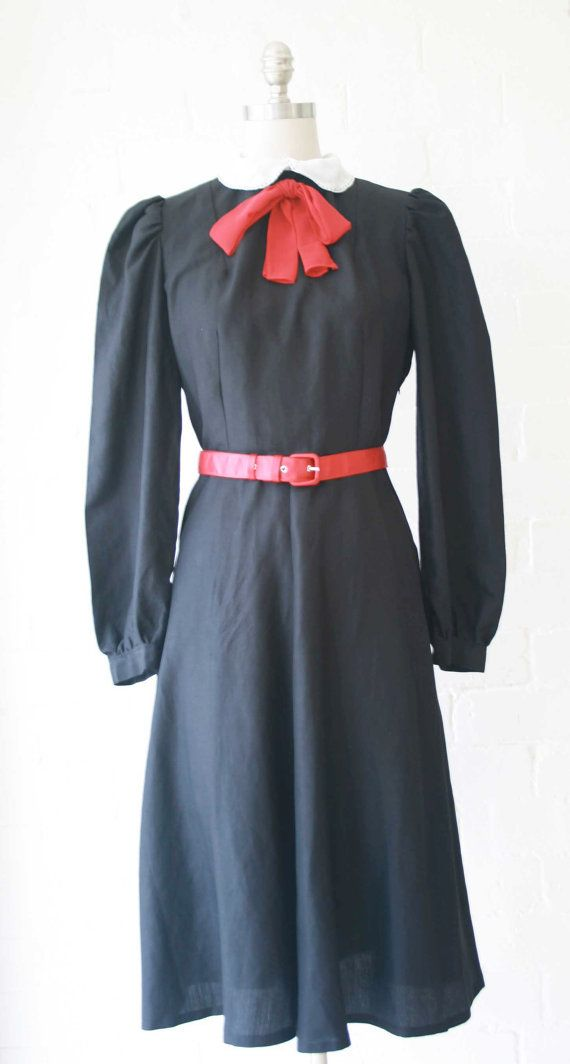 Sweetly wonderful 1940s black long sleeved dress with white collar and red bow. #vintage #1940s #dresses #fashion