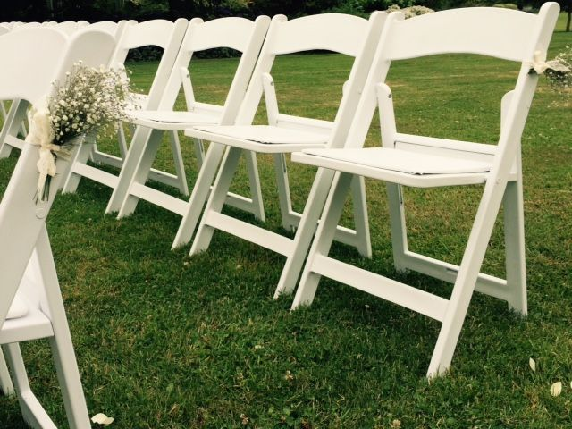 Our Bella Folding chair, placed for a beautiful garden wedding ceremony