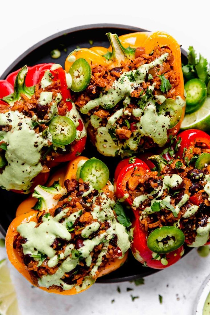 Vegan Stuffed Peppers With Cilantro Lime Crema Plays Well With Butter In 2020 Stuffed Peppers Vegetarian Stuffed Peppers Vegan Stuffed Peppers