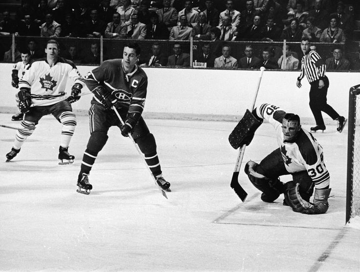 Montreal Canadiens' captain Jean Beliveau faces Toronto Maple Leafs goalie Terry Sawchuk during the 1967 Stanley Cup Final.
