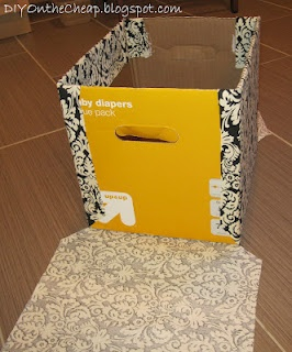 Make a Fabric Storage Box using diaper boxes or a bankers box.