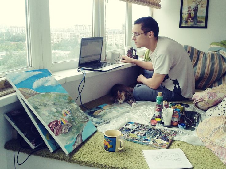bed on a podium, husband, painting, cat, joy