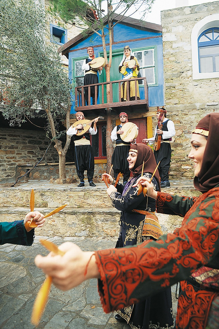 Greek-orthodox festive costumes of the Konya-Niğde region (Cappadocia).  Clothing style: early 20th century.  The dancers use wooden spoons as a kind of castanets; they 'borrowed' the tradition from the Turks, who call these dances 'kaşık oyunları' (spoon play/dances).