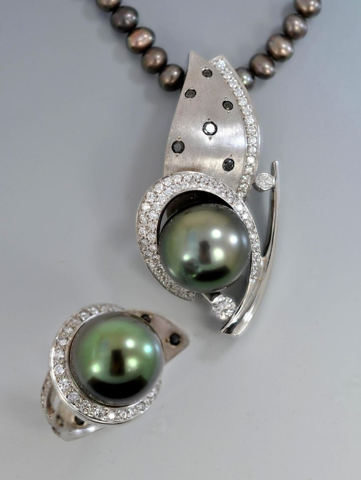 Black #Tahitian #pearl with white and black diamonds in white gold by Alex Gulko