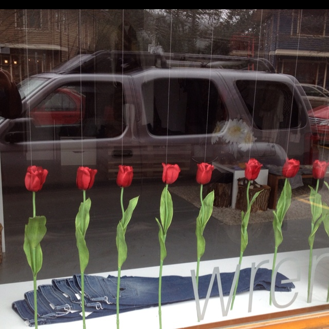 """Elegant (and easily maintained!) window display. I'm thinking a board painted to match the console/tabletop, drilled with holes, switch out varieties of long-stemmed flowers with the season? Needn't be more than 12-18"""" deep, so saves precious floor space for shopping!"""
