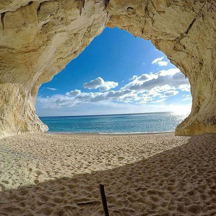 tourism-italy:  Sardinia cant miss in our Saturday summer tips  Cala Luna the wonderful beach-cave in the Gulf of Orosei  repost from @erminiofeola - #calaluna #cala #beach #spiaggia #praia #cava #grotta #bestsea #sea #mare #mediterranean #orosei #baunei #olbia #alghero #costasmeralda #emeraldcoast #cagliari #ryanair #sardegna #sardinia #italia #italy #loveitaly #iloveitaly (presso Cala Luna)