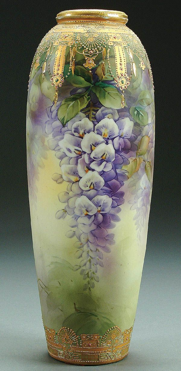A NIPPON ENAMELED JEWELS WISTERIA DECORATED PORCELAIN VASE circa 1900 with all over painted decoration of hanging wisteria below a gilt scro...