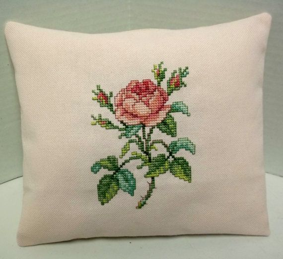 This mini pillow features a single pink rose cross stitched on pale pink Jubilee evenweave fabric. It is backed with muslin and stuffed with poly