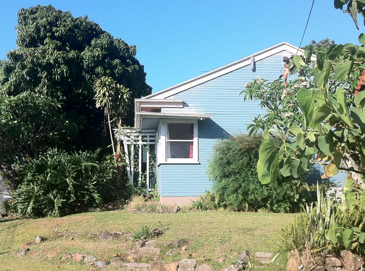Blue. Mango Tree. Odd bits of wood sticking off the side of the house in design. Looking good...