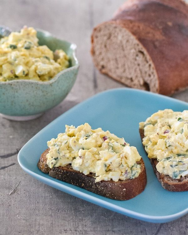yum, egg salad with Greek yogurt  8 eggs  12 leaves fresh basil (you can substitute dried basil, dried dill, or omit if you don't have access to fresh basil)  1/2 cup Greek yogurt  1/2 red onion  2 tablespoons Dijon mustard  1/2 teaspoon kosher salt  Fresh ground pepper to taste
