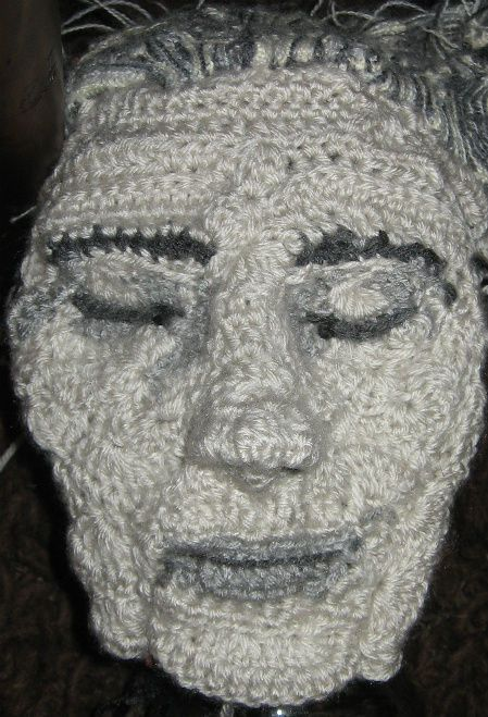 crochet portrait by Pat Ahern  (looks more like a death mask, or is that just me?)