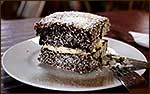 Australian Lamingtons Recipe - Lamingtons Recipe  Lamingtons were originally created as a way to use stale cake. Today it's one of Australia's favourite cakes.  **to read more click on photo**