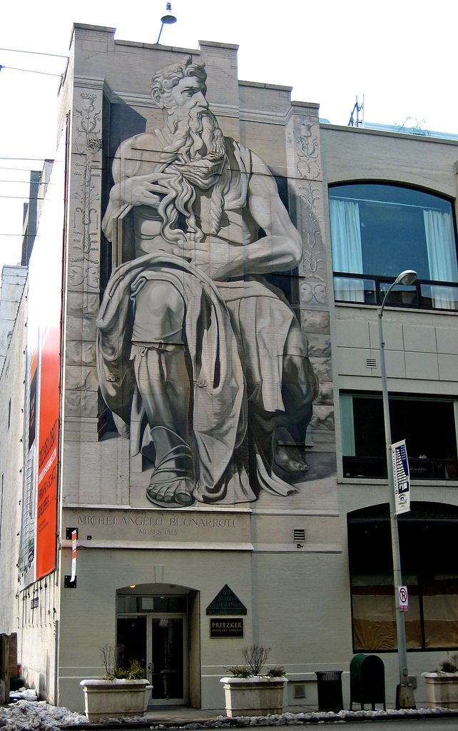 mural of moses on a building in the streeterville area of