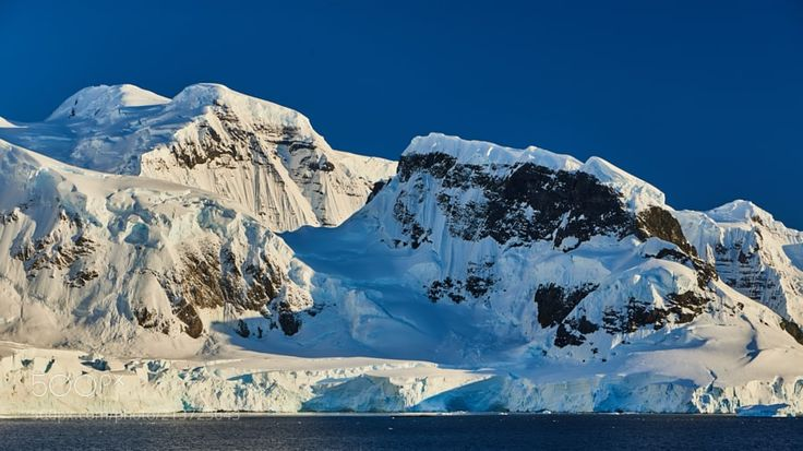 Mountains on Anvers Island by rolandkunz