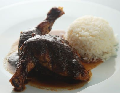 Chicken cooked with tamarind pulp and red curry paste and served with jasmine rice.