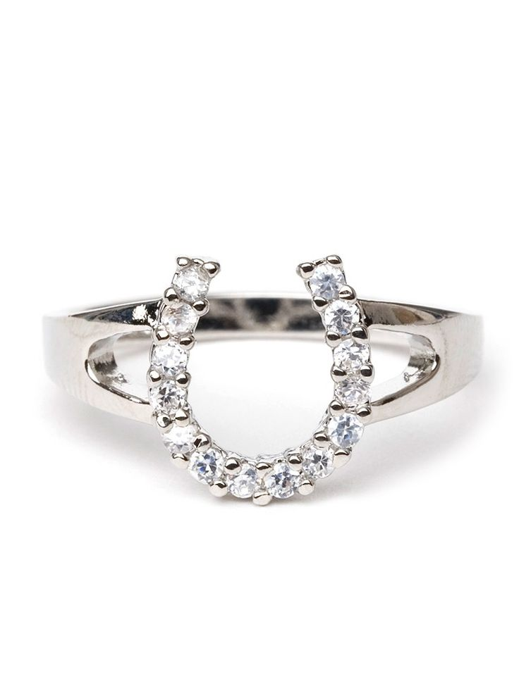 This stylish silver ring is equal measures good luck and glamour. It features an oversized horseshoe motif crafted from sparkling ice-white crystals.