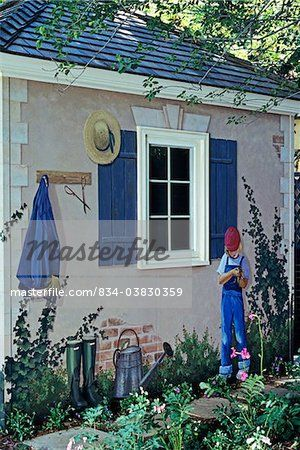 Charming Outbuildings   Potting Shed: Trompe De Lu0027oeil Mural On Outside Wall Depicts  A Standing Girl With Frog, Shutters Around Window, Straw Hat Etc. Photo