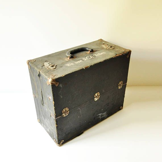 This large amazing RCA TV tube repairmans carry case, with plenty of storage space and full of vintage character dates back to the 1950s. It is made of wood and covered in black vinyl. It is quite large, measures 14 tall, 16.5 long and 8 deep.  It is in used vintage condition, the metal hinges, latches and corners have rusted. The vinyl and wood show wear. It opens and closes as intended, and the latches work well…