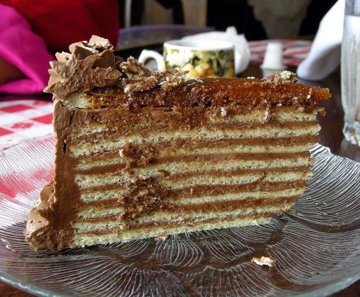 Dobos Torte - super-thin layers of sponge cake, fresh buttercream icing, and a crisp caramel crown - considered to be the Queen of Hungarian desserts!