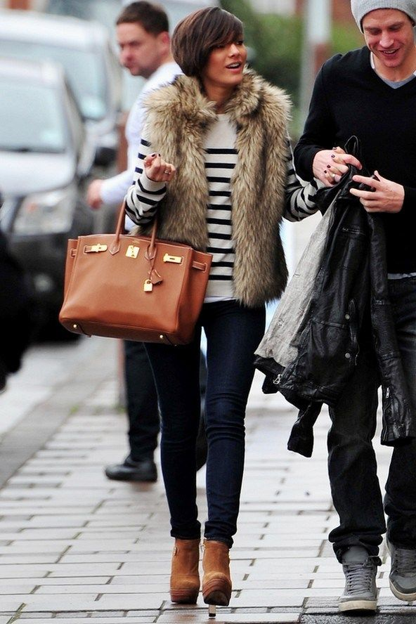 Fur vest over breton stripe top over denim with tan sueded booties | Frankie Sandford