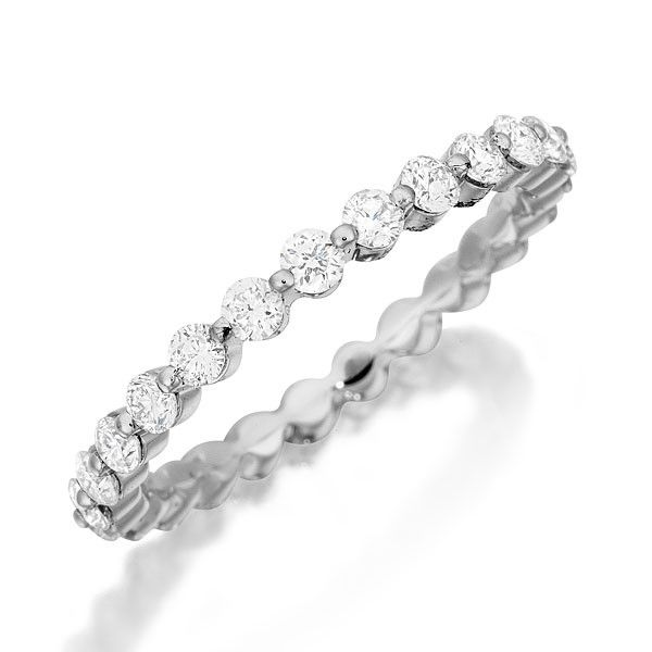 New This gorgeous wedding ring features a single row of hand matched diamonds Band is available with diamonds either halfway around or all the way around