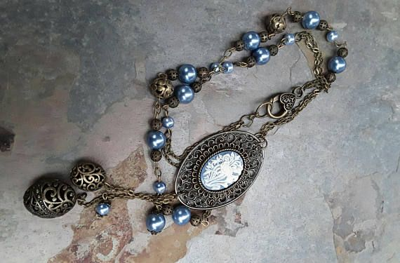 Hey, I found this really awesome Etsy listing at https://www.etsy.com/au/listing/572702196/long-blue-cameo-pearl-beaded-necklace