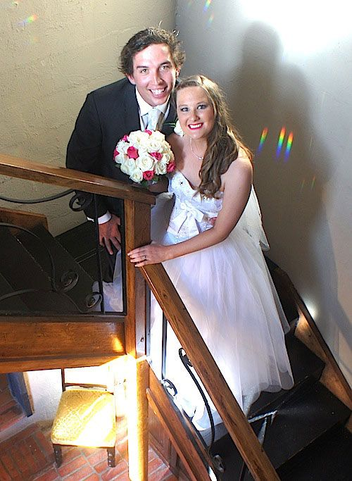 Bride & groom posing on a staircase