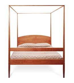 Vermont Shaker Four Poster bed has clean lines, tapered legs, a curved headboard and a canopy frame