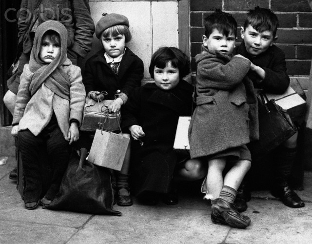 A group of young evacuees awaits transport out of Southampton, England, after their homes are damaged by World War II raids.
