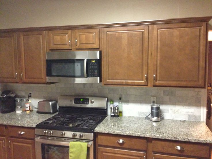 Backsplash with carerra tile. Stock cabinets from lowes ...