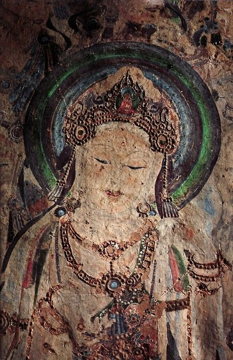 caves of faith- China    crashinglybeautiful:  Portrait of the Bodhisattva Guanyin (7th Century), Dunhuang Caves, Northeastern China  Photo by Tony Law, June 2010 Issue of National Geographic. More here.  (via sharanam)